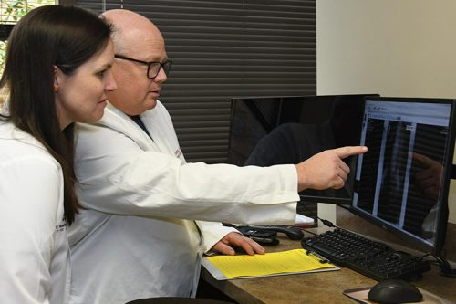 Dr. Smith and Sara Thompson evaluating x-ray